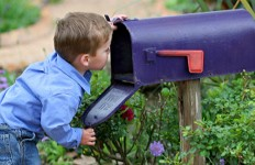 boy-looking-in-mailbox